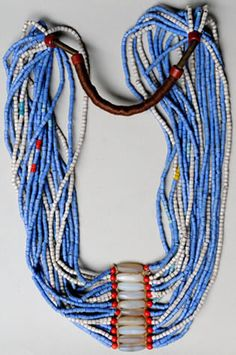 Fulani necklace, Nigeria/Cameroon,  20 strands of old European glass beads, spiral metal beads and yarn. | Early - mid-1900s
