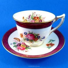 Handpainted Bright Floral with Deep Red Border Cauldon Tea Cup and Saucer