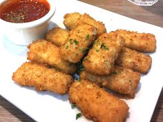 Honey Cornbread Mozzarella Sticks -- the wonderfulness of melted and stringy mozzarella paired with the good homey comfort of corn bread.