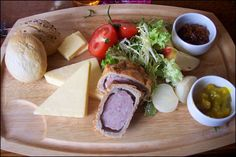 traditional english cheese ploughmans platter also with pork pie, piccalilli, and pickled onions!