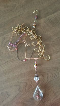 Wire wrapped beaded horse suncatcher, with crystals.