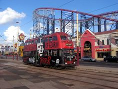 03267 Blackpool Transport Balloon tram car 723 with all over advertising on the Promenade, Pleasure Beach, Blackpool, England, United Kingdom. Blackpool Pleasure Beach, Blackpool England, Locomotive, Balloon, United Kingdom, Transportation, Past, Advertising, Fair Grounds