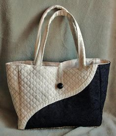 Purse Tote Measures: 8 High x 10 Wide x 4 Deep. Inside lined. No pockets inside or out. Loop-over-button closure.