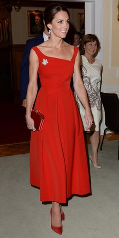 Kate Middleton was a lady in red, arriving at the Government of British Columbia reception in a scarlet Preen by Thornton Bregazzi dress.