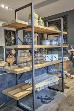 Styling on bookcase made with black structure and 4 shelves…