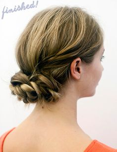 Do a simple braid on each side.  After the braids have been secured with a hair tie, take the two braids and wrap them around each other to form a low bun.  Secure with bobby pins and you've got a sophisticated looking bun.