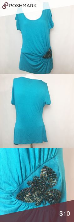"""2b Bebe Fashion Tee 2b Bebe Fashion Tee. Size Large. Color: turquoise. Missing a few decorative pieces but barely noticeable. 36"""" bust, 28"""" length. 2b Bebe Tops Tees - Short Sleeve"""