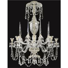 A George III style cut glass chandelier 19th century with eight candle arms, restored, the drip-pans drilled for electricity