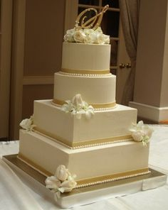 This one is my favorite. I'd love to add the patterns on each layer like the hexagon cake.  wedding cake with gold flowers - Google Search