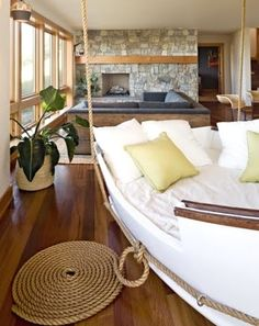 Extreme Nautical Decor: http://www.completely-coastal.com/2012/09/top-5-extreme-decorations.html A suspended boat bed/lounge in a living room.
