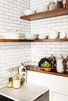 White subway tile in kitchen with wood open shelving // kitchen decorating tips