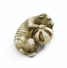 A rare netsuke of a dog playing, in ivory attributed to Okatomo, Japon, Kyoto. XVIII<sup>E</sup> siècle | Lot | Sotheby's