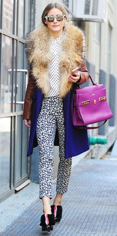 """Look of the Day › February 15, 2014 WHAT SHE WORE During New York Fashion Week, Olivia Palermo braved the blistering cold in style. She paired a polka dot blouse with graphic printed Banana Republic """"Sloan"""" pants, topping it off with a color-blocked fur coat, a Delvaux Tempête Cardinal tote, reflective shades, and black furry booties."""