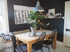 The dining room is painted in Farrow and Ball's Off-Black and Strong White.