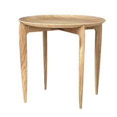 Fritz Hansen's Tray table, also known as Table 4508, is a stylish foldable coffee table designed and crafted in 1958 by Svend Åge Willumsen and Hans Engholm, who worked as cabinetmakers for the Danish company. The minimalist table is not only a great example of the duo's skills in woodworking, but also proves their aptitude for functional design: the table has a removable tabletop and a foldable base, making it the perfect side table for the guest room or other spaces where ext