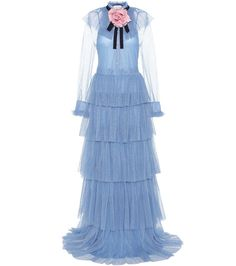 Gucci - Ruffled tulle gown - Channel Gucci's romantic mood with this frilly and floaty floor-sweeping gown. Crafted in Italy from glittering light blue tulle, the piece features a sheer bodice for an alluring finish that is tempered with a matching lining slip. We adore how the detachable rose brooch accents the gorgeous blue hue of the layered, airy design. seen @ www.mytheresa.com
