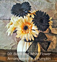 Spooky Flower Arrangements | flowers arranged inside a craft pumpkin are made a little bit spooky ...