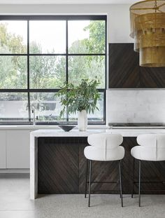 A contemporary kitchen with striking dark timber to house the range hood and as a feature on the island bench. Scandinavian Interior, Contemporary Interior, Dulux Natural White, Bungalow Renovation, British Colonial Style, Interior Architecture, Interior Design, Internal Doors, Kitchen Design