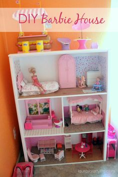 DIY Barbie Dreamhouse - This upcycled bookshelf is bigger and better than what you might get at the toy store, and kids can change up the design as often as they want.