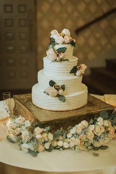 Wedding cake with textured lines | wedding cake with blush flowers | meridian ms wedding cake by Margie's Mixing Bowl