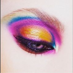 Sunrise eyes by M·A·C Senior Artist @cmil718 at the M·A·C Pro Store in New York City – created using Eye Shadow in Chrome Yellow, Freshwater, Steamy, Parfait Amour, and Mixing Medium Eyeliner mixed with Eye Shadow in Plum Dressing for the liner.  #EyesOnMAC #MACCosmetics #MACPro