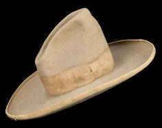 Old cowboy hats look great on old hall trees or hanging on the wall like art. Montgomery Ward & Co. Cowboy Hat. Brian Lebel's Old West Auction. June 11, 2016. Est. $400-500.