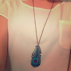 Feather pendant with light blue beads Feather pendant with light blue beads Jewelry Necklaces