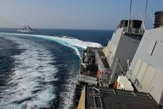 160726-N-FP878-138 BLACK SEA (July 26, 2016) USS Ross (DDG 71) conducts an emergency break away from the Romanian Frigate Marasesti (FF 111) while conducting a replenishment-at-sea  during exercise Sea Breeze 2016 July 26.  Sea Breeze is an air, land and maritime exercise designed to improve maritime safety, security and stability in the Black Sea. (U.S. Navy photo by Mass Communication Specialist 1st Class Theron J. Godbold/Released)