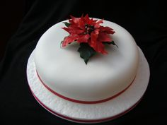 Red Poinsettia - Cake made for my son's teacher for Christmas. As I had to make a poinsettia for my college course it made sense to practise on all the family's cakes first.