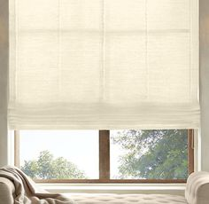 RH's Belgian Sheer Linen Flat Roman Shade:Highly functional and aesthetically clean, our custom Flat Roman Shades ensure that the windows themselves are part of the view. Sewn with a smooth front, they come in a variety of natural materials and fabric options that are also available in our drapery collections – allowing you to combine coverings in the same room, or even on the same window, with perfect ease. May also be layered over our Solar or Blackout Roller Shades.For help w...