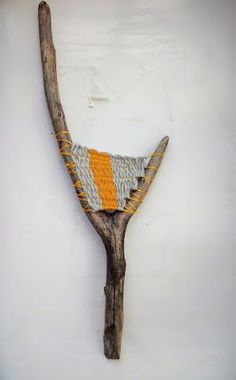 Driftwood weaving with yellow and grey yarn