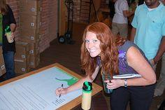 Future hair model, Sara McDaniel, signing the GoGreen Pledge