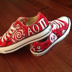 Alpha Omicron Pi, i am gonna have gabe make me a pair of these!