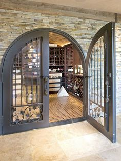 Take a peek inside this stunning modern-rustic Minnesota home Sauvignon Blanc, Cabernet Sauvignon, Caves, Home Wine Cellars, Wine Cellar Design, Double Entry Doors, Door Entry, Door Gate, Minnesota Home