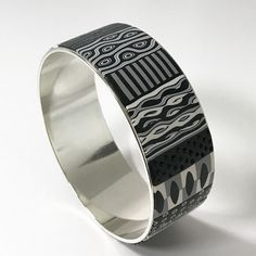 https://flic.kr/p/V9FkTF | Wide black & white bangle | Wide bangle, polymer clay cane patterns over a commercial silver plated base.