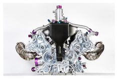 Porsche released photos of half the Le Mans-winning 919 Hybrid, showing off a turbocharged that helps produce 900 overall horsepower for the car. Porsche 919 Hybrid, Porsche 718, Porsche Carrera, Race Engines, Clean And Shiny, Motor Engine, Automotive Design, Race Cars, Super Cars