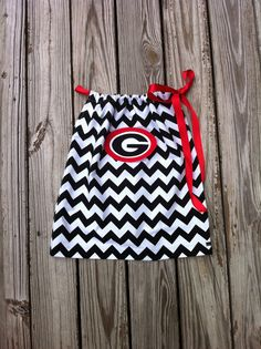 Hey, I found this really awesome Etsy listing at http://www.etsy.com/listing/105995825/custom-boutique-black-white-chevron-uga