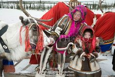 Image of a nenets woman and her daughter dressed up for a spring reindeer herders' festival. yamal, nw siberia, russia by ArcticPhoto