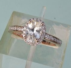 White Sapphire 14k Rose Gold Diamond Halo Engagement Ring September Birthstone Gemstone Engagement Ring. $820.00, via Etsy.