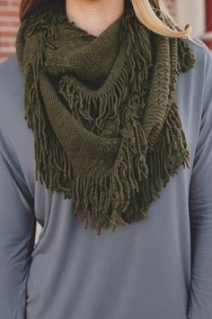 Fall days aren't complete without a visit to an Apple Orchard, just like no Fall outfit is complete without a scarf! Our Apple Orchard Scarf is a pointelle knit infinity scarf with fringe. Imported. 1