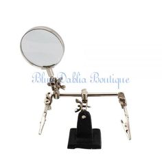 'extra hands 5x magnifier with adjustable clamps' is going up for auction at  2pm Sat, Jan 26 with a starting bid of $8.