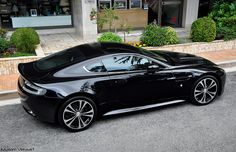 """I have a gift waiting outside for you..."" Aston Martin V12 Vantage Carbon Black Edition."