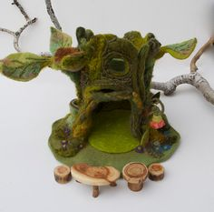 In this case I actually mounted the Mossy Tree Wee Folk shop to a little mat, this kind of house is perfect for the mats as it is also entirely felt