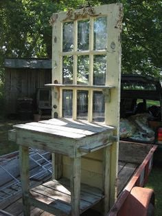 DIY: Artsy Potting Table - made using a salvaged door & salvaged wood.  Dimensions are on the link.
