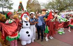 Robin Roberts and Tim Tebow Tape the 2014 Disney Parks Frozen Christmas Celebration TV Special