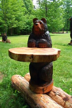 Hey, I found this really awesome Etsy listing at https://www.etsy.com/listing/192157318/black-bear-chainsaw-carved-table