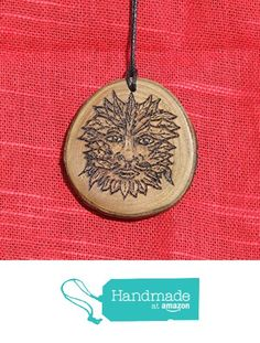 Cherry wood slice pendant with pyrographed green man design. from A Burning Ambition https://www.amazon.co.uk/dp/B01N0CCRZA/ref=hnd_sw_r_pi_dp_9EisybPX8KR87 #handmadeatamazon