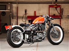 Built by hand, this one-of-a-kind whip sports a 1000cc Ironhead motor producing 75 hp — quite a lot considering its minuscule curb weight — as well as a stretched frame, clip-on handlebars, a custom x-pipe exhaust, powdercoated wheels wrapped in Pirelli rubber, a three-piece rear wing,
