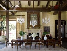 Three 19th-century Bavarian chandeliers are better than one in this Southern California home designed by Martyn Lawrence Bullard.   - ELLEDecor.com