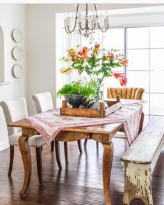 Table, upholstered chairs and a bench.